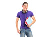 A smiling school boy with headphones holding books