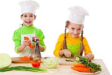 Two girls making salad