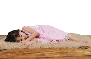 adorable little girl in dress asleep on furry brown rug. isolate