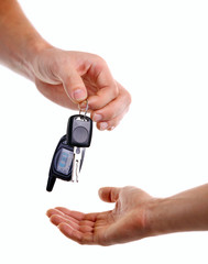 Male hand handing key over to another person