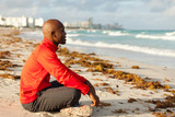 Fototapety Handsome Man Meditating in Miami South Beach