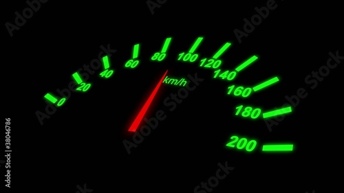 Growing speedometer of a car over black background