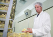 Farmer controls baby chicken in incubator