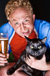 Artistic portrait of young man and his cat both looking at camer