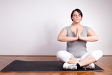 Overweight woman in a yoga position