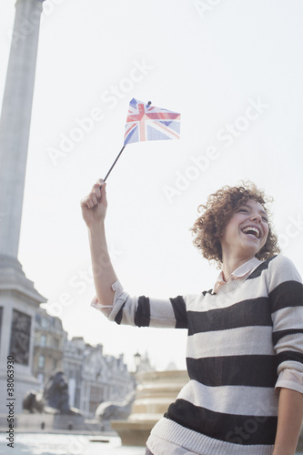 Happy woman holding British flag