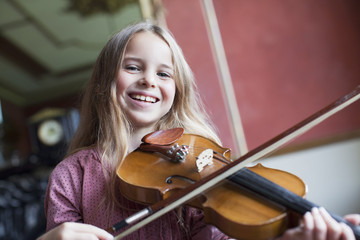 Portrait of smiling girl playing violin
