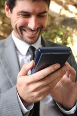 Businessman and his calculator, smiling
