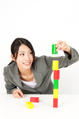 asian businesswoman making building block
