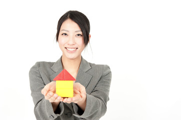 asian businesswoman showing small house