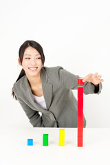 asian businesswoman with colorful building block