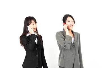 asian businesswomen using smart phone