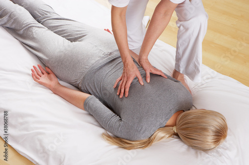 Woman having Shiatsu massage - 38068788