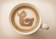 rubber duck drawing latte art on coffee cup