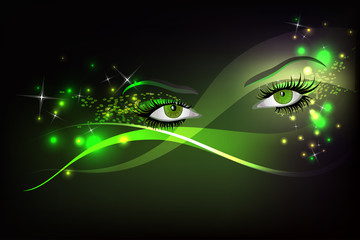 Dark background with green glamour shining  eyes.
