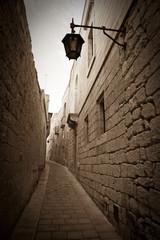 Retro photo of  narrow town street