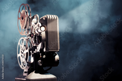 old film projector with dramatic lighting - 38070558