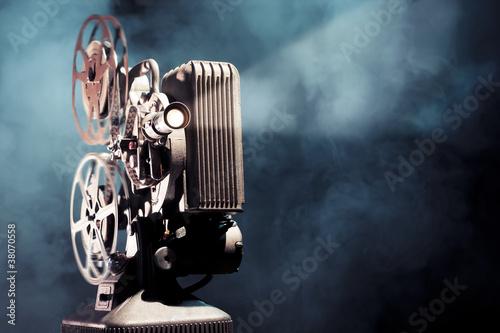 Leinwanddruck Bild old film projector with dramatic lighting