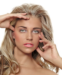 tanned blond woman with long hair