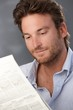 Smiling man with newspaper