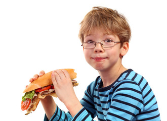boy eating large sandwich