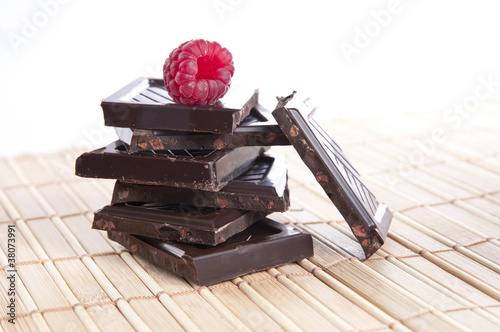 Bar of chocolate with a raspberry on top