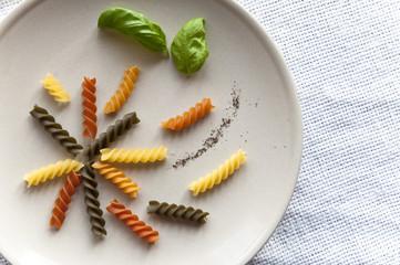 Composed colorful fusilli pasta