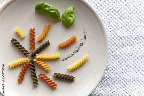 Composed colorful fusilli pasta