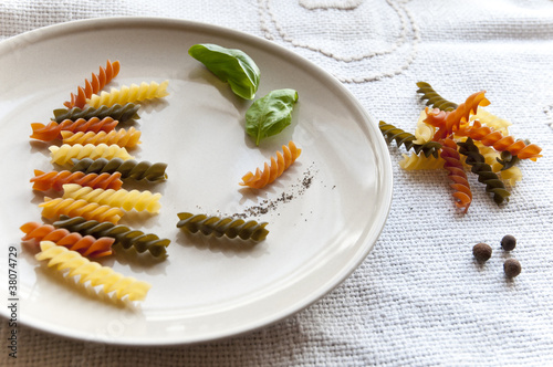 Colorful fusilli with basil and spices