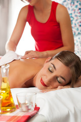 Wellness - woman getting massage in Spa