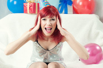 Shocked red-haired party woman