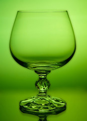 Abstract green wineglass and background