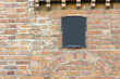 old red  brick wall and  retro sign