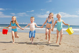 Fototapety Children on beach vacation