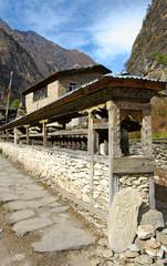 Many prayer wheels in nepal village