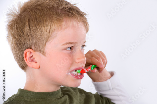 boy is brushing  tooth
