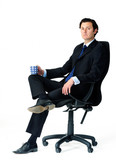 relaxed worker in office chair