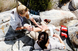 Injured hiker is tended to by her friend