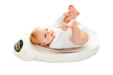 Weighting infant girl isolated on white