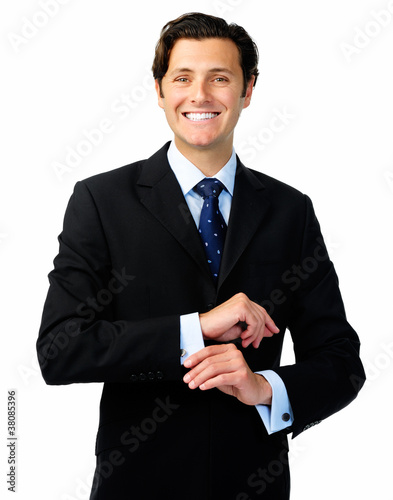 Relaxed businessman makes attire adjustments
