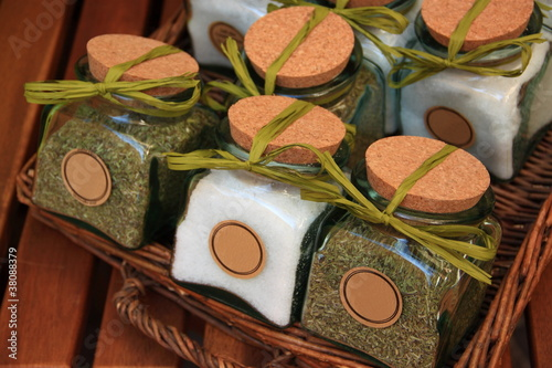 Wicker basket of jars with salt and spices
