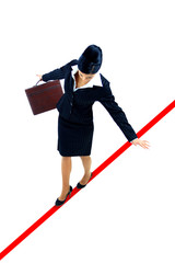 young business woman walking on a tightrope