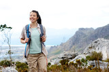 Happy young woman trekking in nature