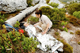 Hiker covered with emergency blanket