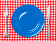 Blue dinner plate with fork and knife
