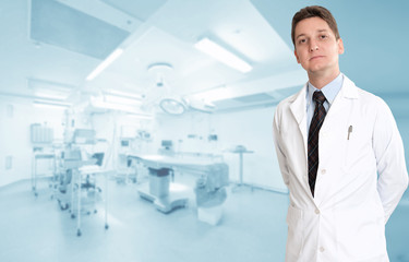 Serious male doctor in operating room