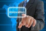 businessman hand pushing innovation button