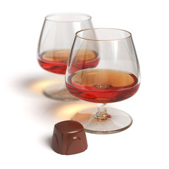 Cognac glasses and chocolate candy