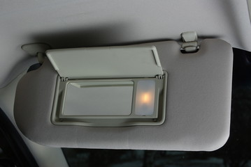 Sun visor with mirror in a car