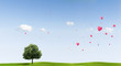 Linden Tree on a meadow with heart balloons
